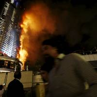 Blaze engulfs Dubai skyscraper as revelers mass for New Year's pyrotechnics; 14 hurt