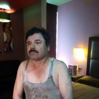Fugitive Mexican drug lord Joaquin 'El Chapo' Guzman sits in a hotel room in Los Mochis in Mexico's Sinaloa state on Friday after being recaptured for a third time. | AFP-JIJI