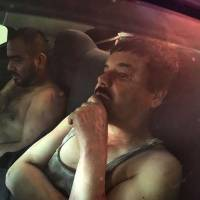 Mexican drug kingpin Joaquin 'El Chapo' Guzman sits in a vehicle after being recaptured in the Sinaloa state city of Los Mochis on Friday. | AFP-JIJI