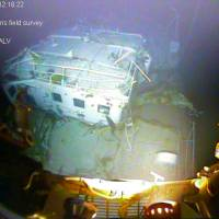 In this photograph released by the National Transportation Safety Board on Sunday, the detached navigation bridge of the sunken freighter El Faro is seen on the seafloor, 15,000-feet deep near the Bahamas. The freighter sank on Oct. 1 after losing engine power and getting caught in a Category 4 hurricane. All 33 crew members aboard were lost at sea. | NATIONAL TRANSPORTATION SAFETY BOARD VIA AP