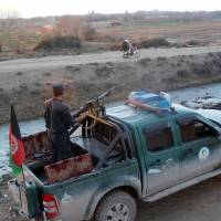 Afghan police patrol Monday in Lashkar Gah, capital of Helmand province. Afghan police are refusing to go back on the streets of a volatile southern district under Taliban attack, claiming that promised government help has not yet arrived, an Afghan official said on Tuesday. | AP