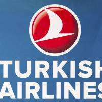 A file picture shows the Turkish Airlines logo at Berlin's Tegel Airport in 2012. A Turkish Airlines flight from Houston was diverted to Shannon, Ireland, on Sunday after officials discovered a handwritten bomb threat, CNN reported.   REUTERS