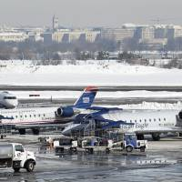 East Coast flights still snarled in wake of massive blizzard