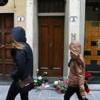 U.S. expat found slain in Florence flat strangled possibly by rope, autopsy finds; boyfriend spat reported
