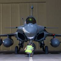 A French army Rafale jet fighter on a base in The Gulf prepares to take part in an Intelligence Surveillance and Reconnaissance (ISR) mission Sunday as part of France's Operation Chammal, began in Iraq in September 2014 before extending to Syria in September 2015, in support of the U.S.-led coalition against Islamic State group. | ECPAD / AFP-JIJI