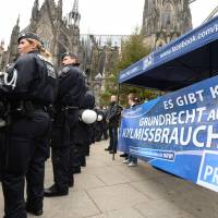 Police secure the area as sympathizers of German right wing party Pro NRW protest in front of the main train station and the Cathedral in Cologne, western Germany, on Wednesday. | AFP-JIJI