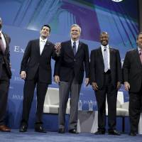 From left: U.S. Sen. Tim Scott and House Speaker Paul Ryan welcome Republican presidential candidates Jeb Bush, Ben Carson and New Jersey Gov. Chris Christie at the 2016 Kemp Forum on Expanding Opportunity in Columbia, South Carolina, on Saturday. The forum featured six presidential candidates and focused on their ideas for fighting poverty and expanding opportunity in America. | REUTERS