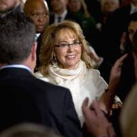 People applaud as former Arizona Rep. Gabby Giffords arrives in the East Room of the White House in Washington, Tuesday, to hear President Barack Obama speak about steps his administration is taking to reduce gun violence. Also attending were other individuals whose lives have been impacted by gun violence. | AP