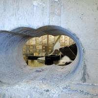 Robbers drilled this hole through the concrete wall of a vault during the Hatton Garden heist in London. | REUTERS