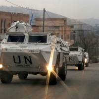 U.N. peacekeepers of the United Nations Interim Force in Lebanon (UNIFIL) patrol on their armored vehicles near Adaisseh village near the Lebanese-Israeli border, southern Lebanon, Monday. | REUTERS