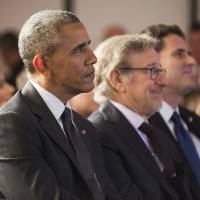 President Barack Obama, left, sits with filmmaker Steven Spielberg, center, and Israeli Ambassador to the US Ron Dermer, right, at the Righteous Among the Nations Award Ceremony at the Israeli Embassy in Washington, Wednesday, Jan. 27, 2016. Obama attended a ceremony for four people who were being honored posthumously for risking their lives to protect Jews during the Holocaust. He also became the first sitting president to speak at the embassy. | AP