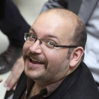 Jason Rezaian, an Iranian-American correspondent for the Washington Post who has been freed from custody in Iran, attends a presidential campaign event of President Hassan Rouhani in Tehran on April 11, 2013. | AP