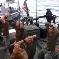 This frame grab from Tuesday video by the Iranian state-run IRIB News Agency shows the detention of American Navy sailors by the Iranian Revolutionary Guards in the Persian Gulf, Iran. The 10 U.S. Navy sailors detained by Iran after their two small boats allegedly drifted into Iranian territorial waters around one of Iran's Persian Gulf islands a day earlier have been freed, the United States and Iran said Wednesday. | IRIB NEWS AGENCY VIA AP