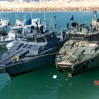 This frame grab from Tuesday video by the Iranian state-run IRIB News Agency, shows American Navy boats in custody of the Iranian Revolutionary Guards in the Persian Gulf, Iran. | IRIB NEWS AGENCY VIA AP