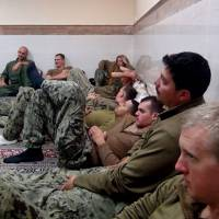 This picture released by the Iranian Revolutionary Guards on Wednesday shows detained American Navy sailors in an undisclosed location in Iran. Iranian state television is reporting that all 10 U.S. sailors detained by Iran after entering its territorial waters have been released. | SEPAHNEWS VIA AP