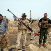 Iraqi security forces and allied Sunni tribal fighters display weapons used by Islamic State militants to attack their city in Haditha, 240 km (150 miles) northwest of Baghdad Tuesday. | AP