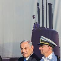 Israeli Prime Minister Benyamin Netanyahu (left) attends a ceremony for the arrival of the German-made INS Rahav, the fifth Israeli Navy submarine, at the military port of Haifa on Tuesday. | AFP-JIJI