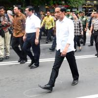 In this photo provided by Indonesia Presidential Office, Indonesian President Joko Widodo visits the site of the attacks in Jakarta Thursday. Attackers set off suicide bombs and exchanged gunfire outside a Starbucks cafe in Indonesia's capital in a brazen assault Thursday. | CAHYO BRURI SASMITO / INDONESIA PRESIDENTIAL OFFICE VIA AP