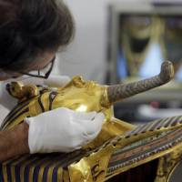 German restorer Christian Eckmann begins restoration work at the Egyptian Museum in Cairo last October on the golden mask of King Tutankhamun over a year after the beard was accidentally broken off and hastily glued back on with epoxy. Egyptian prosecutors have referred to trial eight restorers involved in the botched repair of the famed golden burial mask of King Tut.   AP