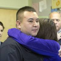 La Loche Mayor Kevin Janvier and Georgina Jolibois, his predecessor, who is now a member of parliament, hug after talking to reporters about Friday's shooting at a school in the Saskatchewan town. | AP