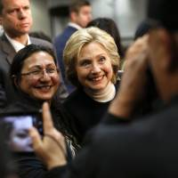 Democratic presidential candidate Hillary Clinton (right) poses for a photograph after speaking at a town hall at the Toledo Civic Center in Toledo, Iowa, Monday.   AP