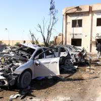 Truck bomb kills at least 60 cops at coastal Libya base that targets traffickers; Islamic State suspected