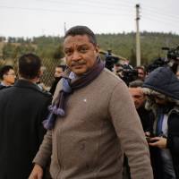 U.N. humanitarian coordinator for Syria Yacoub El Hillo looks on after talking to journalists as a convoy of aid from the Syrian Arab Red Crescent waits on the outskirts of besieged rebel-held Syrian town of Madaya, on Thursday. | AFP-JIJI