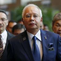 Malaysian Prime Minister Najib Razak arrives at the opening of the International Conference on Deradicalization and Countering Violent Extremism in Kuala Lumpur on Monday. | REUTERS
