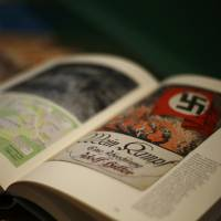 A copy of 'Hitler, Mein Kampf: A Critical Edition' sits on a display table in a bookshop in Munich on Friday. | REUTERS