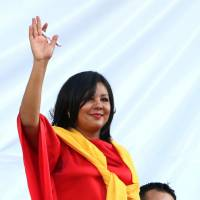 Gisela Mota waves Friday during her swearing in ceremony as mayor of Temixco, Morelos State, Mexico. The Morelos state Public Security Commission says attackers invaded Mota's house on Saturday morning and killed her. | AP