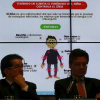 Graph of the symptoms of the Zika virus is seen behind of Colombia's Health Minister Alejandro Gaviria (right) during a news conference on the Zika virus in Bogota Wednesday. | REUTERS