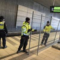 A temporary fence is erected between the domestic and international train tracks at Hyllie train station in Malmo, Sweden, on Sunday. From Monday, authorities will operate border controls for people entering Sweden from Denmark — a stop away on train and bus lines. | AP