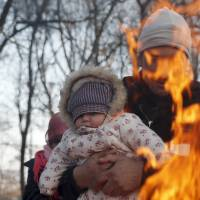 Macedonia halts migrants at Greek border as Serbia, Croatia narrow flow to just Germany, Austria