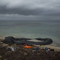 A dinghy is left behind on a shore close to the town of Mytilene, shortly after dozens of refugees and migrants used it to cross a part of the Aegean sea from Turkey to the Greek island of Lesbos, Tuesday. | AP