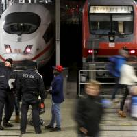 German police secure the main train station in Munich on Friday. | REUTERS