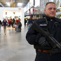 A German policeman patrols the main train station in Munich on Friday. | REUTERS
