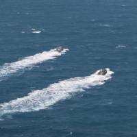 A handout picture released Wednesday by the news website and public relations arm of Iran's Revolutionary Guards, Sepah News, shows U.S. Navy patrol boats sailing after their release by Iranian authorities. | IRAN'S REVOLUTIONARY GUARDS WEBSITE / HO / AFP-JIJI