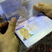 A handout image grab taken from a video released on Wednesday by the Islamic Republic of Iran's News Network (IRINN) shows the passport of a U.S. Navy sailor on Farsi Island after Iran's Revolutionary Guards apprehended U.S. patrol boats that had entered Iranian waters unintentionally, a statement said. | HO / IRINN / AFP-JIJI