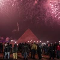 Egyptians celebrate the New Year in front of the pyramids nearCairo on Friday. | AFP-JIJI
