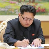 This picture taken on Sunday in Pyongyang and released on Thursday shows North Korean leader Kim Jong Un signing a document for a hydrogen bomb test. | KCNA via KNS / AFP-JIJI