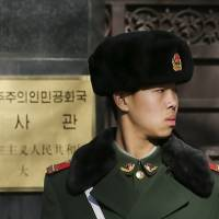 A soldier stands guard at the main gate of the North Korean Embassy in Beijing on Wednesday. | REUTERS