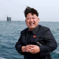 North Korean leader Kim Jong Un laughs following the test-firing of a strategic submarine-launched ballistic missile in this undated file photo released in May. | REUTERS