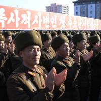 North Korean military personnel clap during a rally to celebrate a purported hydrogen bomb test, in Kim Il Sung Square in Pyongyang on Friday. | AP