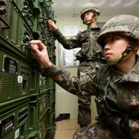 South Korean soldiers adjust equipment used for propaganda broadcasts near the borderline in Yeoncheon on Friday. | AP