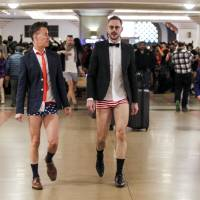 Scotland Beaver (left) and Mathew Spencer in the annual No Pants Metro Ride walk through Union Station on Sunday in Los Angeles. | AP