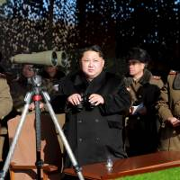 North Korean leader Kim Jong Un watches a firing contest between artillery units at an undisclosed location in this photo released by North Korea's Korean Central News Agency on Tuesday. | KCNA / REUTERS