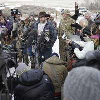 Ammon Bundy, one of the sons of Nevada rancher Cliven Bundy, speaks with reporters during a news conference at Malheur National Wildlife Refuge headquarters Monday near Burns, Oregon. Bundy, who was involved in a 2014 standoff with the government over grazing rights, told reporters on Monday that two local ranchers who face long prison sentences for setting fire to land have been treated unfairly. | AP
