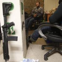Ammon Bundy talks to occupiers in an office at the Malheur National Wildlife Refuge near Burns, Oregon, Wednesday. The leader of a group of armed men who took over a U.S. wildlife refuge in remote southeastern Oregon said on Wednesday they know they will have to go home, but that they want to see progress on their grievances first and it is not 'quite time yet.' | REUTERS