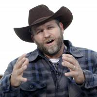 Ammon Bundy speaks during an interview earlier this month at the Malheur National Wildlife Refuge near Burns, Oregon. Authorities said Tuesday that Bundy, leader of an armed Oregon group at the refuge, had been arrested. | AP