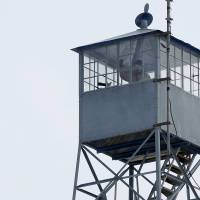 A watch tower is manned by occupiers at the Malheur National Wildlife Refuge near Burns, Oregon, Monday. The leaders of a group of self-styled militiamen who took over the U.S. wildlife refuge headquarters over the weekend said on Monday they had acted to protest the federal government's role in governing wild lands.   REUTERS